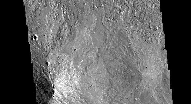 This image from NASAs Mars Odyssey shows part of the summit caldera of Arsia Mons.