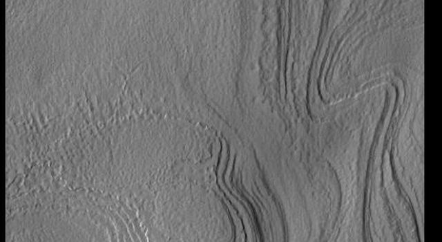 This image from NASAs Mars Odyssey shows part of the south polar cap. The numerous layers that comprise the polar cap are readily visible.