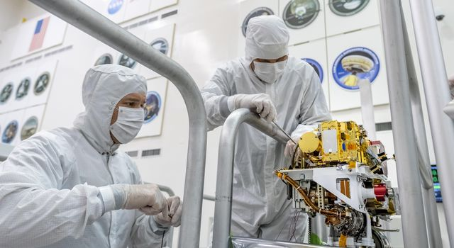 Engineers install the SuperCam instrument on Mars 2020s rover. This image was taken on June 25, 2019.