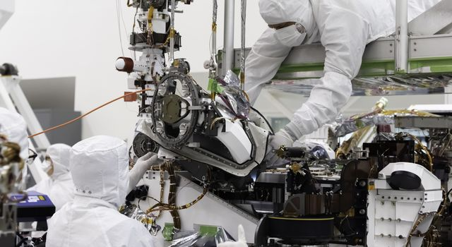 In this August 5, 2019 image, the bit carousel, the heart of sampling and caching subsystem of NASAs Mars 2020 mission, is attached to the front end of the rover.