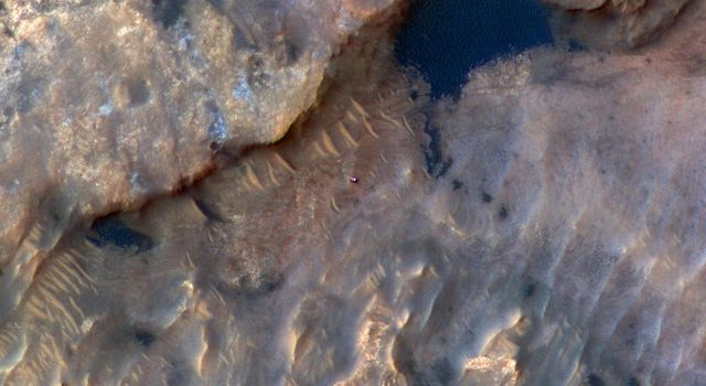 NASAs Curiosity Mars rover can be seen in this image taken from space on May 31, 2019, by the HiRISE camera aboard the Mars Reconnaissance Orbiter.