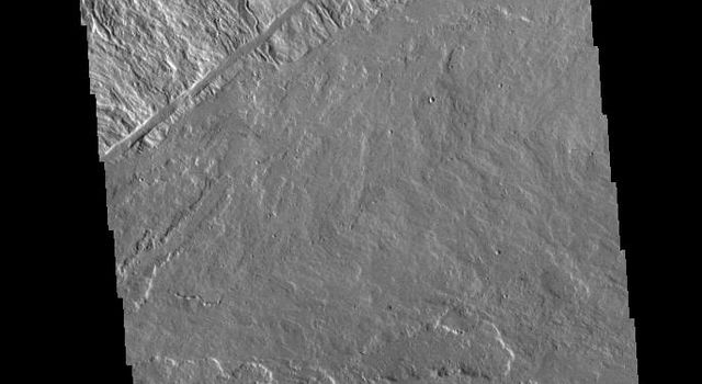 This image from NASAs Mars Odyssey shows where the southeastern flank of Ascraeus Mons meets the surrounding volcanic plains.