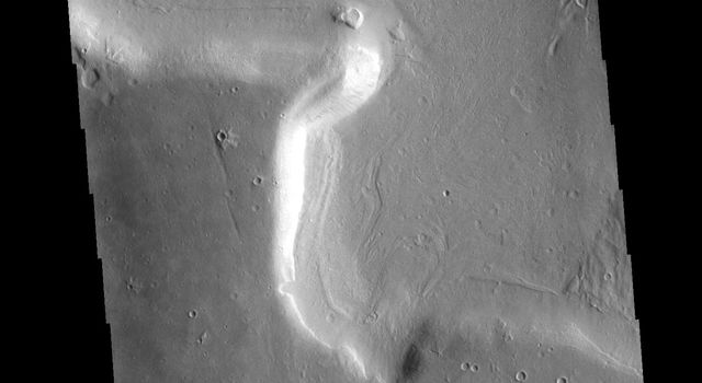This image from NASAs Mars Odyssey shows part of an unnamed channel in the margin between Arabia Terra and the surrounding lowlands.