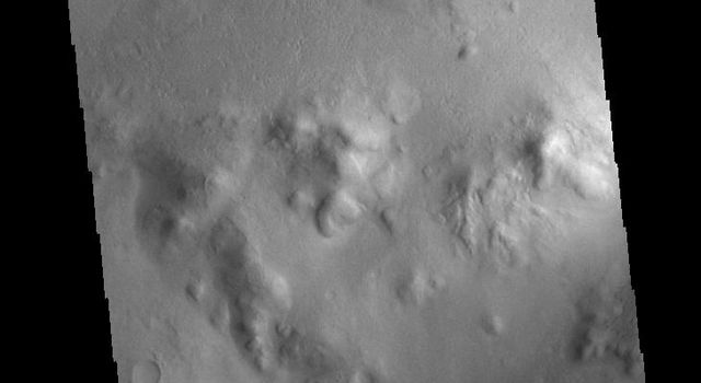 This image from NASAs Mars Odyssey shows Lyot Crater, a large, complex crater in the northern lowlands of Vastitas Borealis.