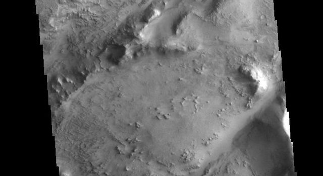 This image from NASAs Mars Odyssey shows two linear depressions which are part of the Nili Fossae fracture system.