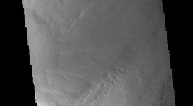 This image from NASAs Mars Odyssey shows Biblis Patera, the summit caldera of the volcano Biblis Tholus.