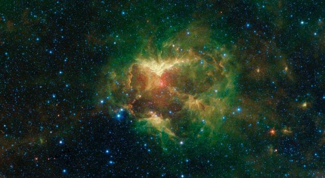 This infrared image from NASAs Spitzer Space telescope shows a cloud of gas and dust carved out by a massive star. A drawing overlaid on the image reveals why researchers nicknamed this region the Jack-o-lantern Nebula.