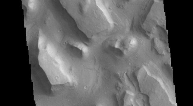 This image from NASAs Mars Odyssey shows part of Chryse Chaos near the terminal end of the huge outflow channels draining from Valles Marineris into the Chyrse Basin.