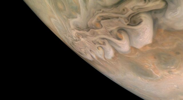NASAs Juno spacecraft captured this impressive image revealing a band of swirling clouds in Jupiters northern latitudes during Junos close flyby on Nov. 3, 2019.