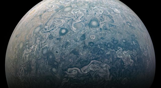 NASAs Juno spacecraft captured this view of a chaotic, stormy area of the planets northern hemisphere known as a folded filamentary region.