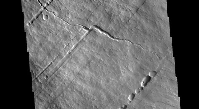 This image from NASAs Mars Odyssey shows part of the southwestern flank of Pavonis Mons. Pavonis Mons is the central volcano of the three large Tharsis volcanoes.
