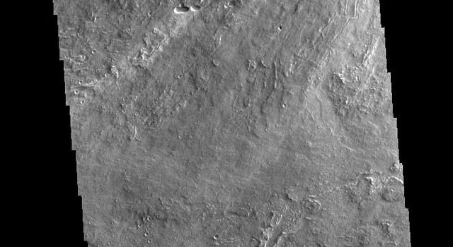 This image from NASAs Mars Odyssey shows a portion of Daedalia Planum. Daedalia Planum is a huge lava flow field that originates at Arsia Mons.