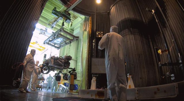 This time-lapse video, taken on Oct. 9, 2019, at NASAs Jet Propulsion Laboratory in Pasadena, California, captures the move of the Mars 2020 rover into a large vacuum chamber for testing in Mars-like environmental conditions.