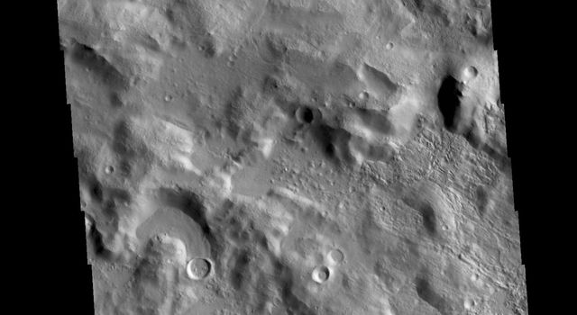 This image from NASAs Mars Odyssey shows the Cerulli Crater rim.
