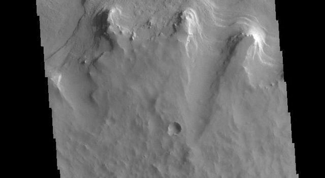 This image from NASAs Mars Odyssey shows one of several craters located on the floor of the much larger Tikhonravov Crater in Terra Sabaea.