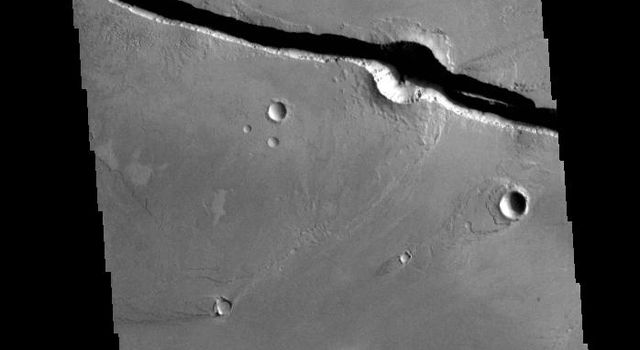 This image from NASAs Mars Odyssey shows linear depressions, graben, that are called Cerberus Fossae.