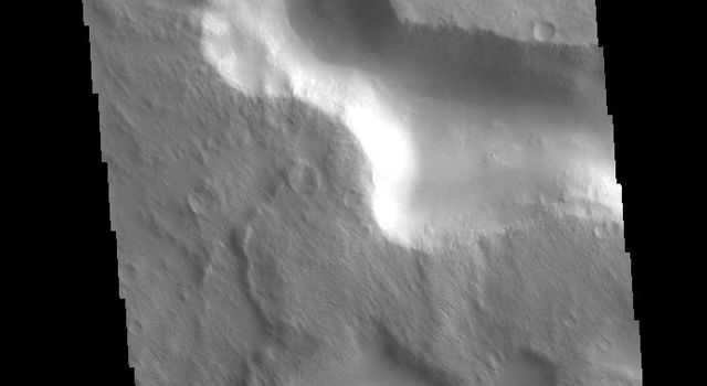 This image from NASAs Mars Odyssey shows a channel located on the western margin of Medusae Fossae.