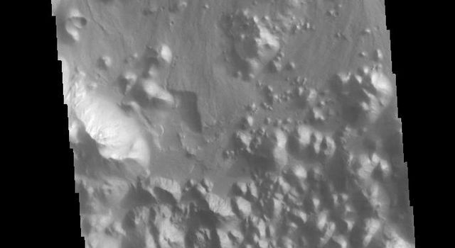This image from NASAs Mars Odyssey shows part of Aronatum Chaos. Aromatum Chaos is a depression about 90 km (56 mi) long by 30 km (20 mi) wide.