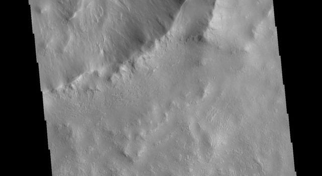 This image from NASAs Mars Odyssey shows the southeastern portion of Micoud Crater. Micoud Crater is located in Vastitas Borealis.
