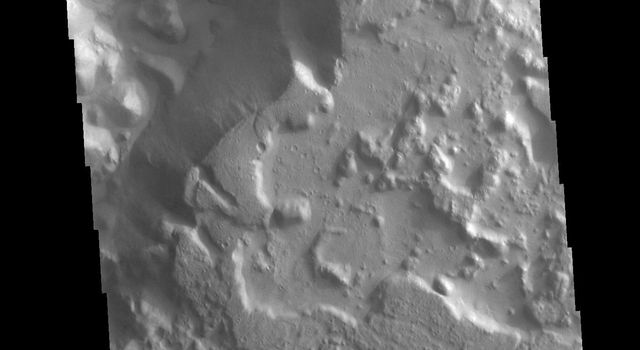This image from NASAs Mars Odyssey shows a region of chaos near the terminal end of Morava Valles.