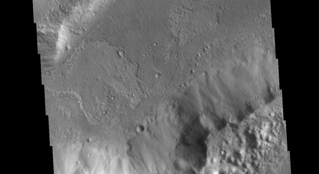 This image from NASAs Mars Odyssey shows a section of Shalbatana Vallis. Located in Xanthe Terra, Shalbatana Vallis is one of many channels that empty into Chryse Planitia.