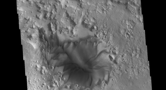 This image from NASAs Mars Odyssey shows an interesting sand dune on the floor of an unnamed crater in Terra Sabaea.