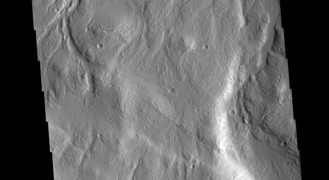 This image from NASAs Mars Odyssey shows part of the northern margin of Acheron Fossae.