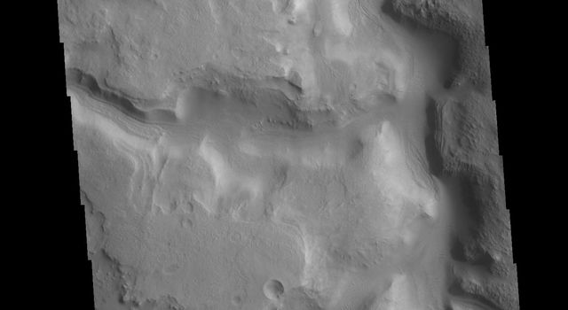 This image from NASAs Mars Odyssey shows part of Huo Hsing Valles, located in northern Terra Sabaea.