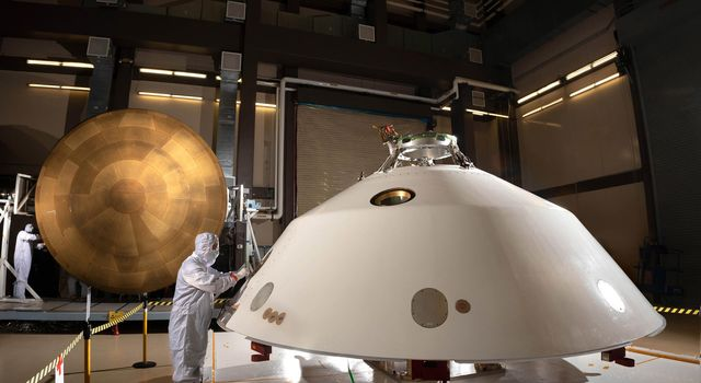 The heat shield (left) and back shell (right) that comprise the aeroshell for NASAs Mars 2020 mission are depicted in this image.
