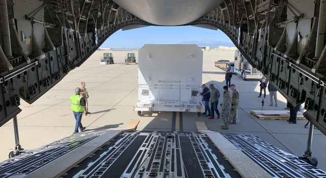 The shipping container carrying NASAs Mars 2020 rover is readied for loading aboard an Air Force C-17 transport plane at March Air Reserve Base in Riverside, California, on Feb. 11, 2020.