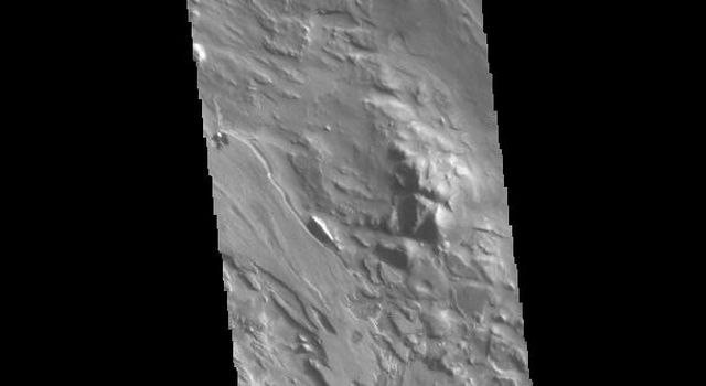 This image from NASAs Mars Odyssey shows part of Aram Chaos. Aram Chaos was initially formed by a large impact.