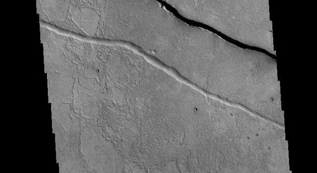 This image from NASAs Mars Odyssey shows linear depressions which are part of the Cerberus Fossae fracture system.