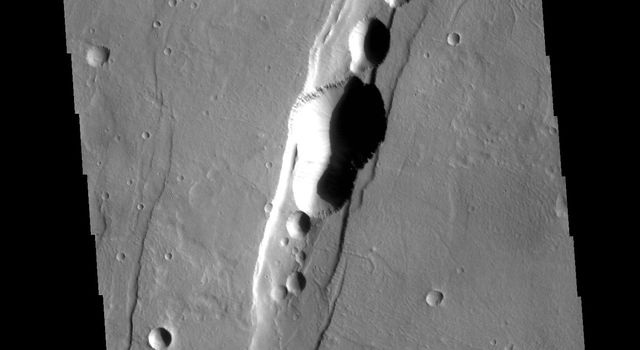This image from NASAs Mars Odyssey shows part of Tractus Catena, just one of many north/south trending tectonic graben located south and east of Alba Mons.
