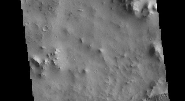 This image from NASAs Mars Odyssey shows a linear depression, part of Cerberus Fossae.