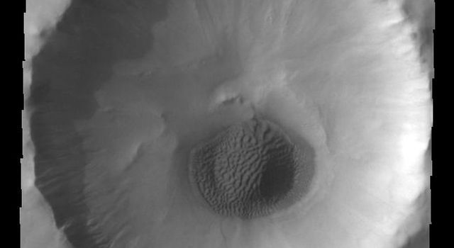 This image from NASAs Mars Odyssey shows a small unnamed crater in northern Acidalia Planitia.