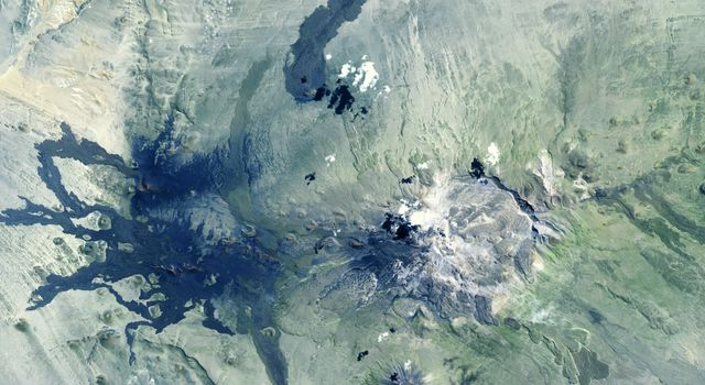 NASAs Terra spacecraft shows Payun Matru, a large shield volcano capped by a caldera, located in the Andean Volcanic Belt in Argentina.
