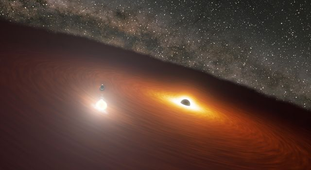 This animation shows two massive black holes in the OJ 287 galaxy.