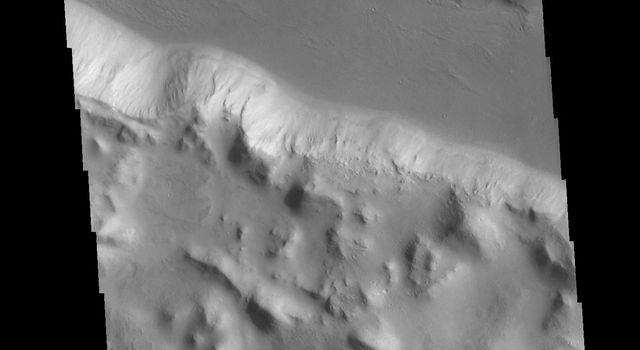 This image from NASAs Mars Odyssey shows one of the linear depressions of Cerberus Fossae.