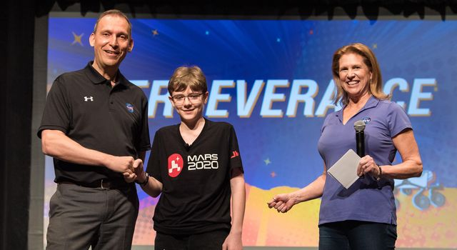 NASAs Thomas Zurbuchen and Lori Glaze congratulate Alexander Mather, the seventh grader who submitted the winning entry Perseverance to the agencys Name the Rover essay contest.