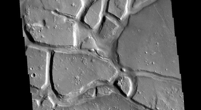 This image from NASAs Mars Odyssey shows Galaxias Chaos, located on the northern border of the Elyisum volcanic complex.