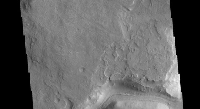 This image from NASAs Mars Odyssey shows a channel called Auqakuh Vallis and is located in northern Terra Sabaea.