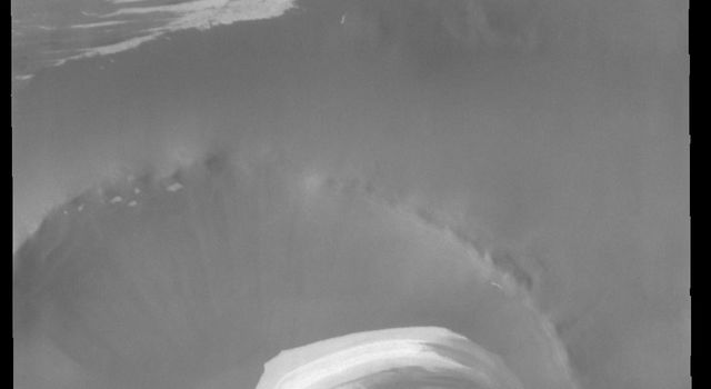 This image from NASAs Mars Odyssey shows Inuvik Crater. Located near the north polar cap, this crater is 20 km (12 miles) in diameter.