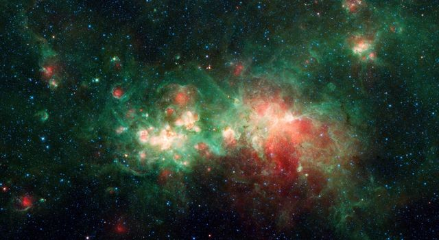 This image from NASAs Spitzer Space telescope shows the star-forming nebula W51, one of the largest star factories in the Milky Way galaxy.