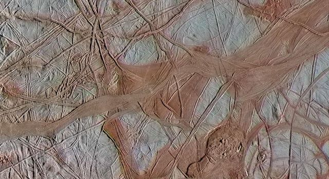 The surface of Jupiters moon Europa features a widely varied landscape, including ridges, bands, small rounded domes and disrupted spaces that geologists called chaos terrain.
