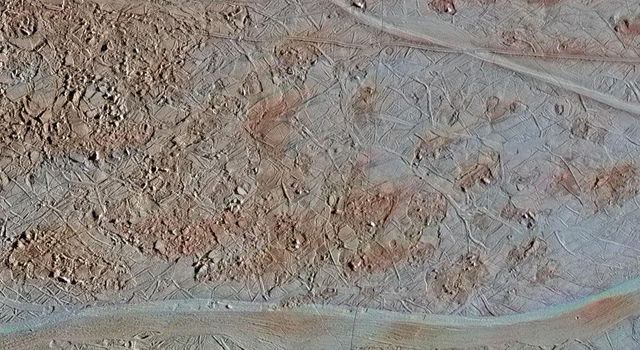 This image of Europa shows a region of blocky chaos terrain, where the surface has broken apart into many smaller chaos blocks that are surrounded by featureless matrix material.