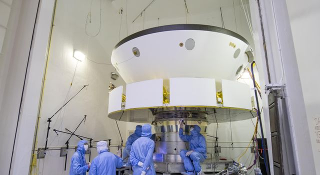 The spacecraft that will carry NASAs Perseverance rover to Mars is examined prior to an acoustic test in the Environmental Test Facility at the Jet Propulsion Laboratory in Southern California.