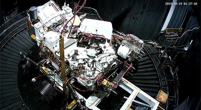 This animated GIF shows the deployment of the Perseverance rovers remote sensing mast during a cold test in a space simulation chamber at NASAs Jet Propulsion Laboratory.