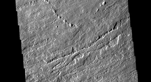 This image from NASAs Mars Odyssey shows flank flows on the east side of Olympus Mons.