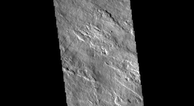 This image from NASAs Mars Odyssey shows the eastern flank of Arsia Mons, the southernmost aligned volcano in the Tharsis region.
