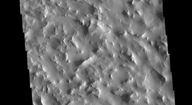 This image from NASAs Mars Odyssey shows a rugged region near the northern end of Gordii Dorsum.